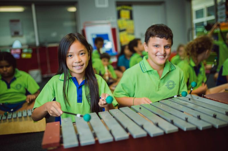 Students playing xylophone