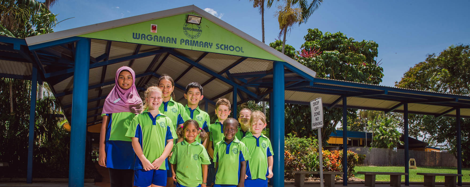 Our students standing outside the front of the school